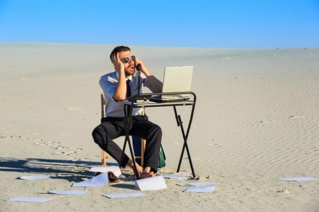 businessman-using-laptop-desert_155003-2401